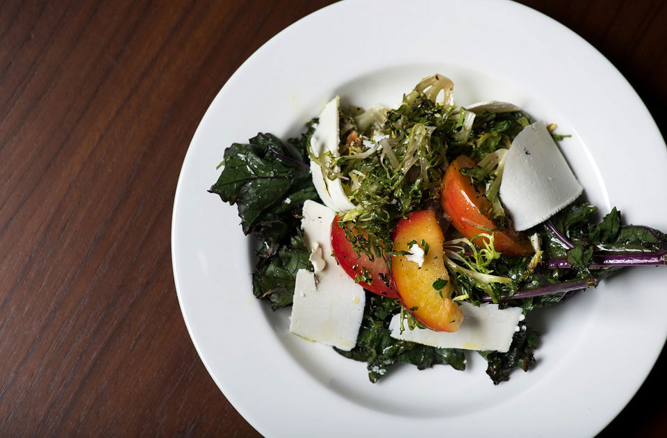 Salad of embered kale with vinegared plums and salted ricotta